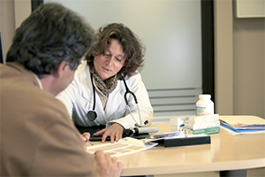 Doctor in the consulting room with a patient